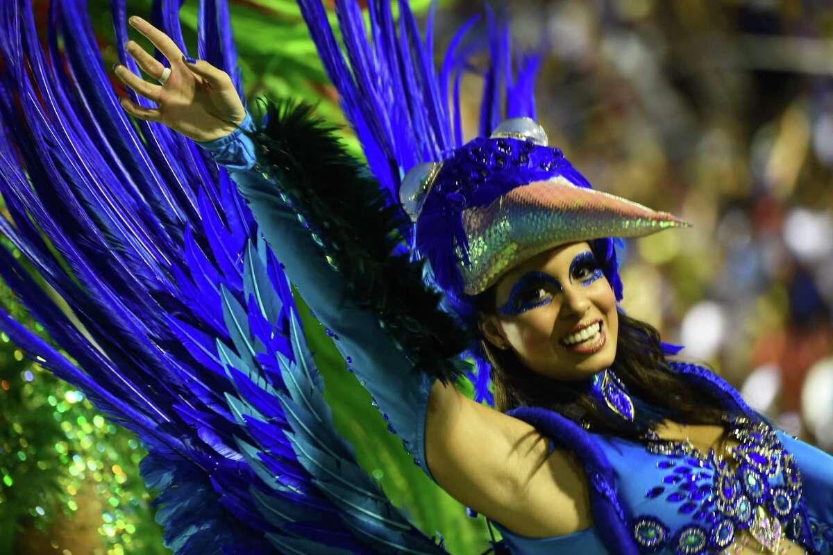 Revelers of the Portela samba school perform during the second night of carnival parade at the Sambodrome in Rio de Janeiro, Brazil on Feb. 16, 2015.