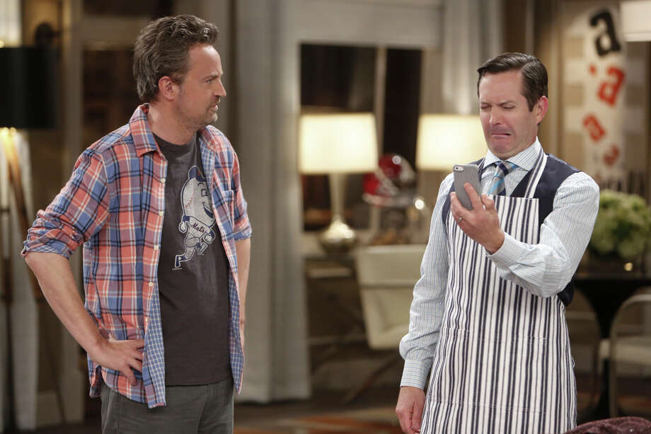 """""""The Odd Couple"""" stars Matthew Perry, left, as endearing slob Oscar Madison and Thomas Lennon as uptight neat freak Felix Unger, two former college buddies who become unlikely roommates. Photo: Cliff Lipson, STF / Ì?å©2014 CBS Broadcasting, Inc. All Rights Reserved"""