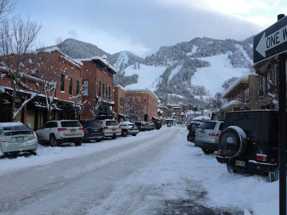 Downtown Aspen butts up against Aspen Mountain , famous for its black diamond terrain. Photo: Jeannie Ralston / For The Express-News