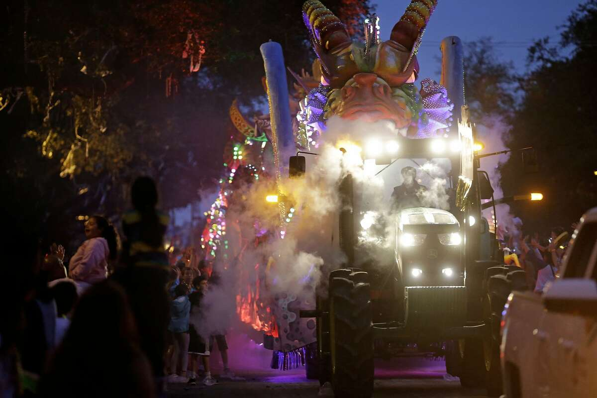 A float in the Krewe of Proteus passes down Napoleon Avenue during their Mardi Gras parade in New Orleans, Monday, Feb. 16, 2015. The day is known as Lundi Gras, the day before Mardi Gras. (AP Photo/Gerald Herbert)