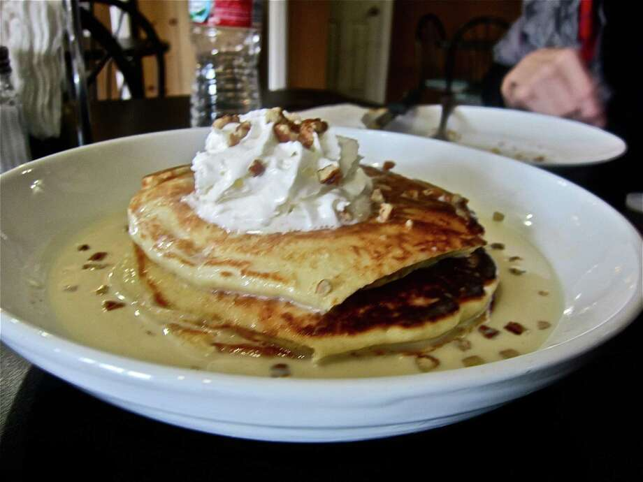 "Move over, Aladdin and Jasmine. There's a local eatery that Houston Chronicle food critic Alison Cook describes as a ""big-hearted magic carpet ride."" Kitchen 713, located at 4515 Canal, earned a respectable 2-star review from our food critic. And it's not hard to see why. Take a look at these tres leches pancakes from the brunch menu and you'll know why this restaurant got Cook soaring.Though, in order to make the most of your meal, Cook says you will need to hone in on one important virtue. Keep clicking to take a look at what else is being served up at Kitchen 713. Photo: Alison Cook / ONLINE_YES"