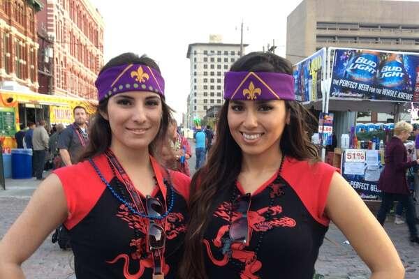Revelers celebrate Mardi Gras in Galveston's historic Strand District on Saturday, February 14, 2015.