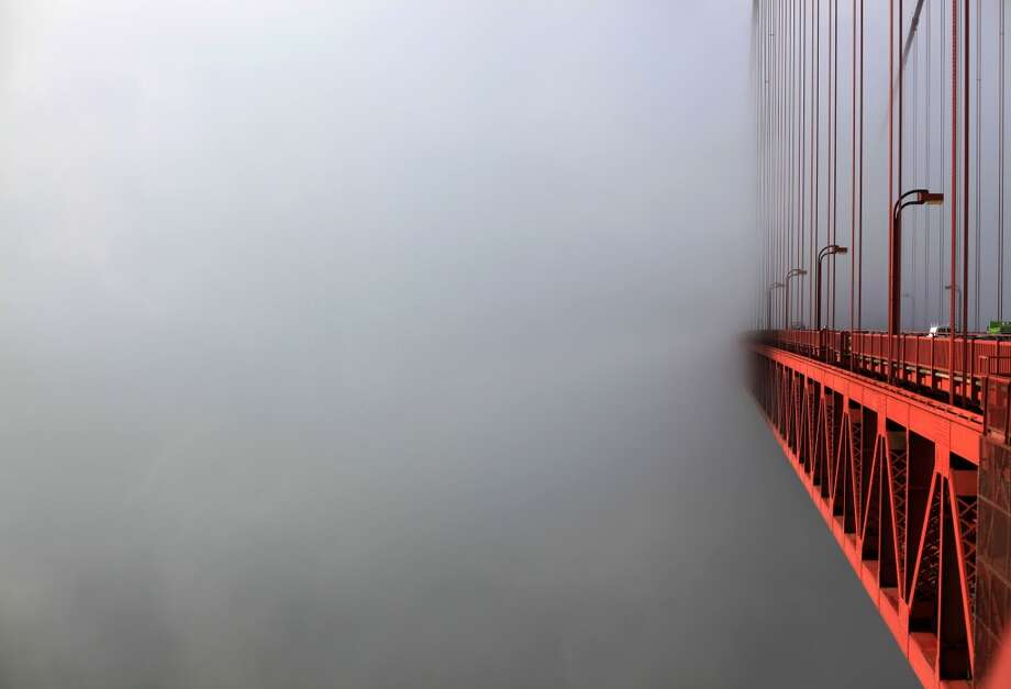 A streamlined fog bank hides the south end of the Golden Gate Bridge on May 8, 2012 in San Francisco, Calif. Photo: Mike Kepka, The Chronicle