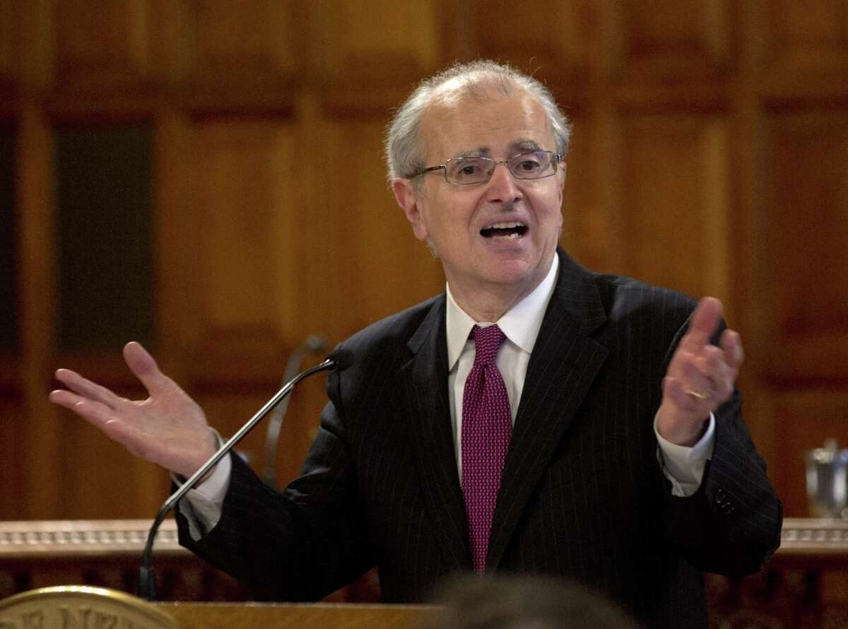 """Chief Judge Jonathan Lippman speaks during a Law Day event at the Court of Appeals on Wednesday, April 30, 2014, in Albany, N.Y. Lippman has proposed reforming consumer debt cases in state courts with new filing requirements for collectors of so-called """"zombie"""" debts. (AP Photo) ORG XMIT: NYMG110 ORG XMIT: MER2014050117572851"""