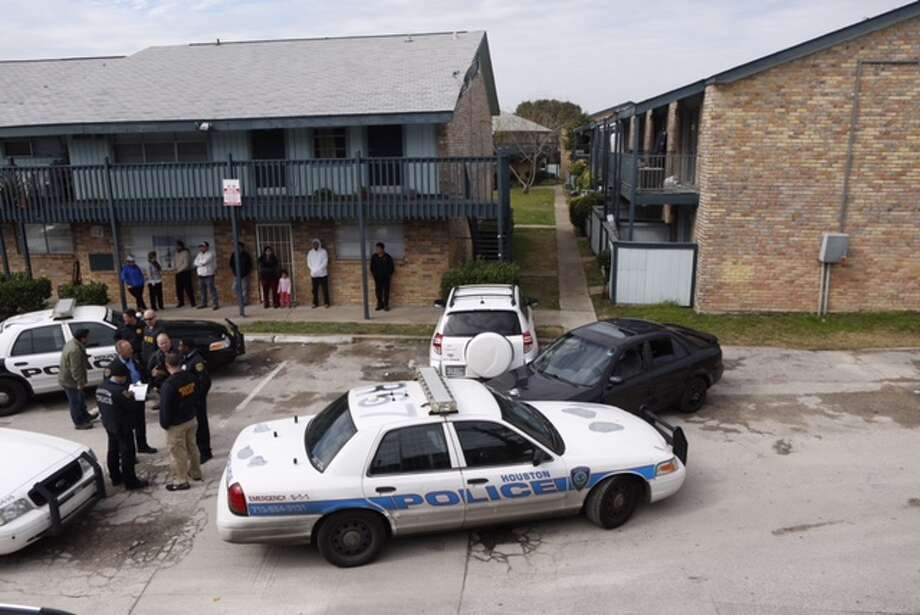 A police officer was injured Tuesday morning when a car hit him after a report of a burglary at an apartment complex in southwest Houston. Photo: Cody Duty | Houston Chronicle