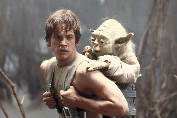 """FILE - This image provided by Lucasfilm Ltd. shows Mark Hamill as Luke Skywalker and the character, Yoda, in a scene from the 1980 movie """"Star Wars Episode V: The Empire Strikes Back."""" As astronomers debate whether it would be a good idea to send signals into the universe to look for extra-terrestrial life, in science-fiction movies, aliens sometimes come in peace — and often do not. (AP Photo/Lucasfilm Ltd.)"""