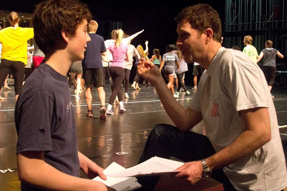 """Ty Doran, who plays the role of director in """"A Chorus Line"""" at The Kinkaid School, listens to his father Justin, who is director of the musical. Ty, 15, is a junior at Kinkaid. """"A Chorus Line"""" will be presented Feb. 26-27, March 1 at The Katz Performing Arts Center.         Ty Doran, who plays the role of director in """"A Chorus Line"""" at The Kinkaid School, listens to his father Justin, who is director of the musical. Ty, 15, is a junior at Kinkaid. """"A Chorus Line"""" will be presented Feb. 26-27, March 1 at The Katz Performing Arts Center. Photo: Hobbes Reynolds"""