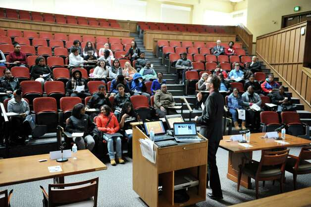 Albany Law School professor Robert Heverly talks to high school students about copyright law at Youth Law Day at the Albany Law School on Tuesday, Feb. 17, 2015, in Albany, N.Y.  The program is sponsored by the New York State Bar Association's Committee on Diversity and Inclusion.  The event was last held in 2008.  The goal of the program is to introduce high school students to the legal profession and the law school experience.   (Paul Buckowski / Times Union) Photo: PAUL BUCKOWSKI / 00030583A