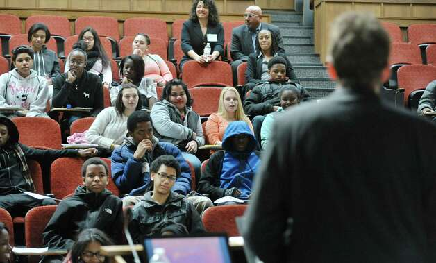 High school students listen as Albany Law School professor Robert Heverly talks about copyright law at Youth Law Day at the Albany Law School on Tuesday, Feb. 17, 2015, in Albany, N.Y.  The program is sponsored by the New York State Bar Association's Committee on Diversity and Inclusion.  The event was last held in 2008.  The goal of the program is to introduce high school students to the legal profession and the law school experience.   (Paul Buckowski / Times Union) Photo: PAUL BUCKOWSKI / 00030583A