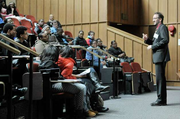 Albany Law School professor Robert Heverly has a discussion about copyright law with high school students at Youth Law Day at the Albany Law School on Tuesday, Feb. 17, 2015, in Albany, N.Y.  The program is sponsored by the New York State Bar Association's Committee on Diversity and Inclusion.  The event was last held in 2008.  The goal of the program is to introduce high school students to the legal profession and the law school experience.   (Paul Buckowski / Times Union) Photo: PAUL BUCKOWSKI / 00030583A