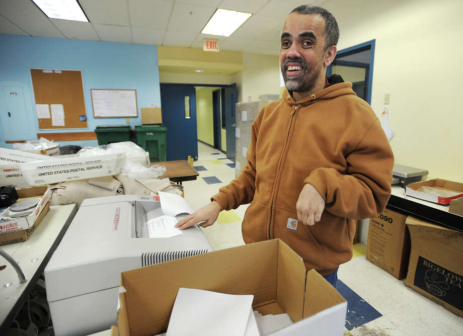 Client Francisco Amaro, of Bridgeport, shreds documents in The Workshop, an on site work facility at the Kennedy Center at 39 Lindeman Drive in Trumbull, Conn. on Tuesday, February 17, 2015. Advocates hope the shop won't close due to budget cuts, as they say many clients function better working at the center than they would in a mainstream situation. Photo: Brian A. Pounds / Connecticut Post