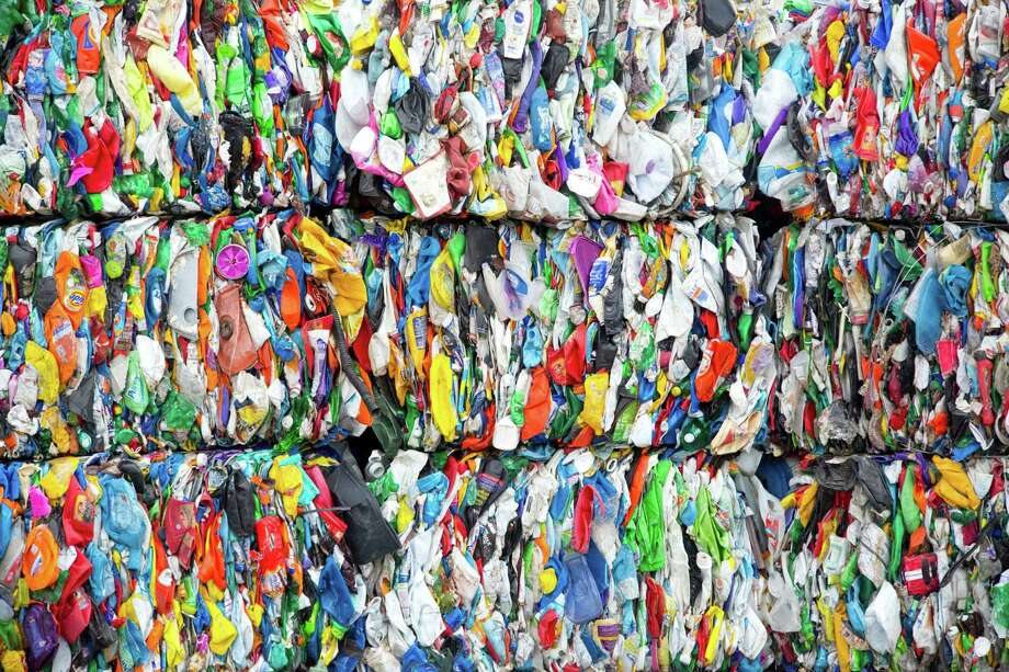 Bales of plastic that has been sorted and compressed at the Waste Management Recycling Facility Thursday November 20, 2014 in Southwest Houston, TX. (Billy Smith II / Houston Chronicle) Photo: Billy Smith II, Staff / © 2014 Houston Chronicle
