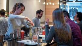 Bartender Lauren Steele pours a cocktail at Liholiho Yacht Club in San Francisco.