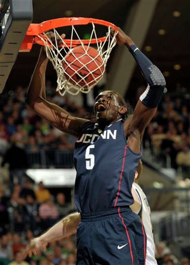 Connecticut forward Ater Majok dunks the ball in the first half of an NCAA college basketball game against Notre Dame Wednesday, March 3, 2010, in South Bend, Ind. (AP Photo/Joe Raymond) / Joe R. Raymond
