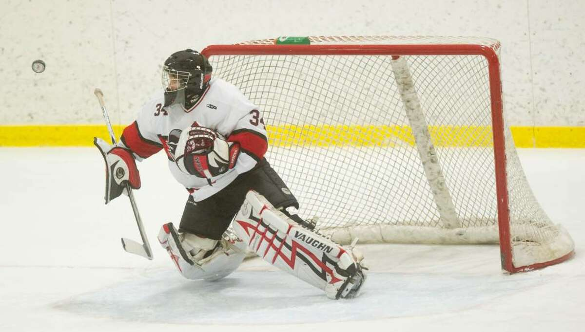 New Canaan's Tim Nowacki makes a save during the semi-final round of the FCIAC boys hockey tournament against St. Joes at Terry Conners Rink in Stamford, Conn. on Wednesday, March 3, 2010.u