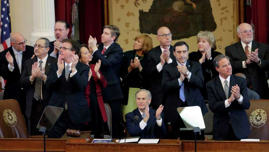 Texas Gov. Greg Abbott, bottom middle, applauds veterans during his State of the State address to a joint session of the House and Senate, Tuesday, Feb. 17, 2015, in Austin, Texas. (AP Photo/Eric Gay) Photo: Eric Gay, Associated Press / AP