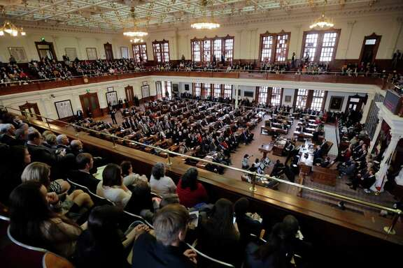 Texas Gov. Greg Abbott delivers his State of the State address to a joint session of the House and Senate, Tuesday, Feb. 17, 2015, in Austin, Texas. Abbott told lawmakers that roads, education and border security are the biggest issues facing Texans. (AP Photo/Eric Gay)