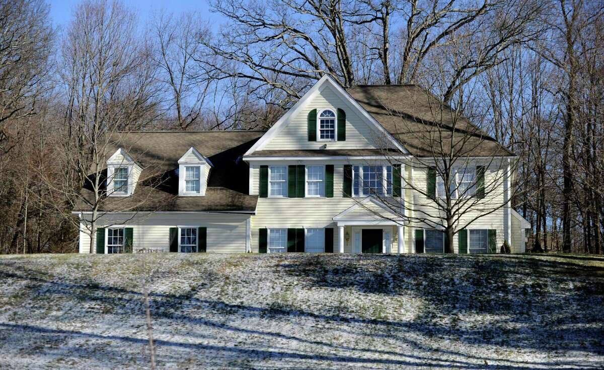 This house at 36 Yoganada St. in Newtown, Conn. was the home Sandy Hook Elementary School shooter Adam Lanza and his mother Nancy. Photo taken Tuesday, January 13, 2015.
