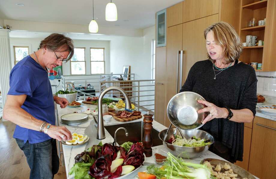 Chefs John Clark and Gayle Pirie, owners of Foreign Cinema, cook in their newly remodeled kitchen. Photo: Russell Yip / The Chronicle / ONLINE_YES