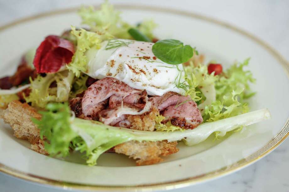Seared Duck Breast Salad with Poached Egg and Chicory made by chefs Gayle Pirie and John Clark, owners of Foreign Cinema. Photo: Russell Yip / The Chronicle / ONLINE_YES