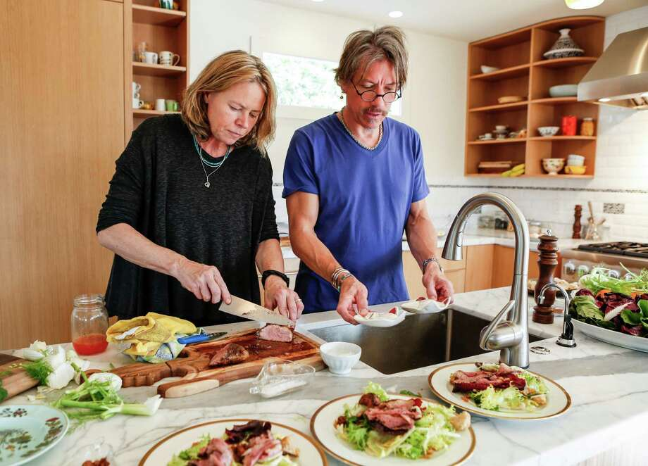 Chefs Gayle Pirie and John Clark, who own Foreign Cinema in S.F., make seared duck breast salad in the remodeled kitchen of their Berkeley home. Photo: Russell Yip / Photos By Russell Yip / The Chronicle / ONLINE_YES