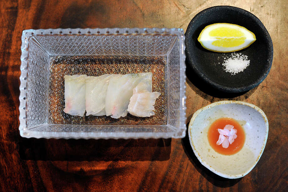 Raw diamond turbot served with plum sauce and lemon at S.F.'s Saison, where chef Joshua Skenes practices ikejime, a Japanese way of handling fish. Photo: Michael Short / Special To The Chronicle / ONLINE_YES
