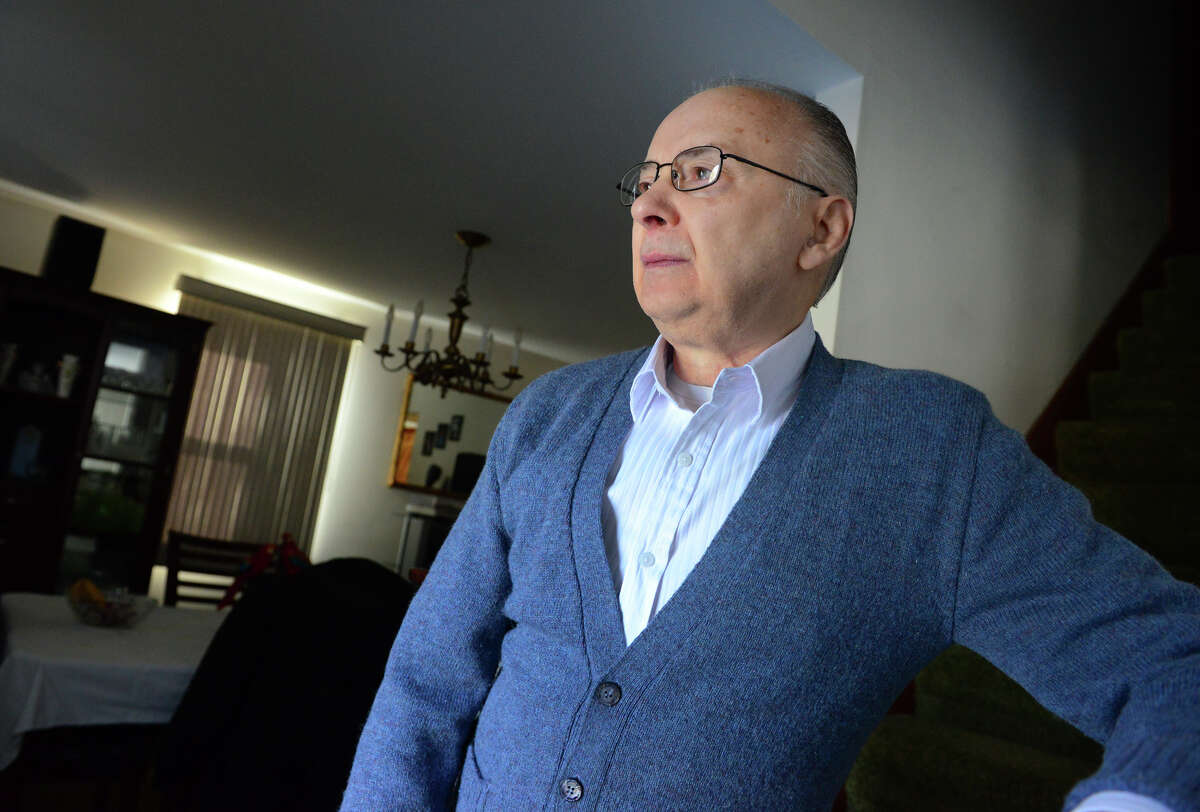 Vincent Bartold, who is suing Wells Fargo, on behalf of the Connecticut Fair Housing Agency over unsavory reverse mortgage practices, poses at his home in Stratford, Conn. on Tuesday Feb. 17, 2015.