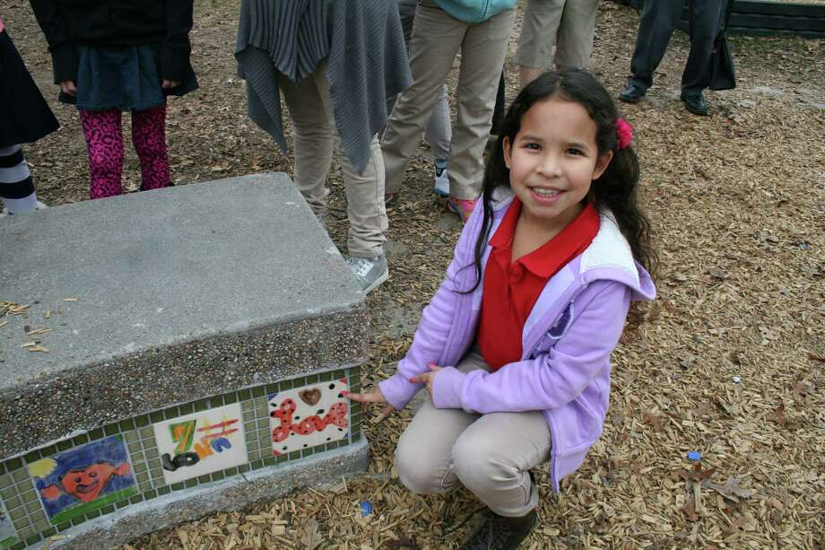 Helms Elementary School fourth-grader Angelina Olvera painted a tile that went on a bench as part of work to refurbish the SPARK Park near the school. Photo: Tom Behrens