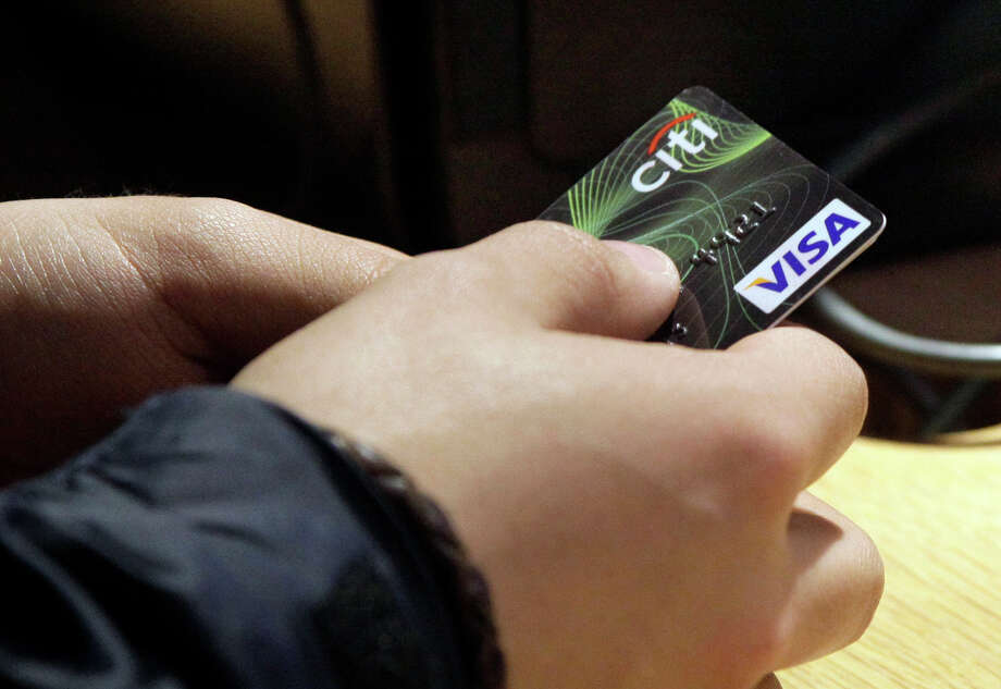 Visa wants to track its customers' smartphones to know when a credit card is legitimately used in locations away from the holder's home area. Photo: Richard Drew / Associated Press / AP