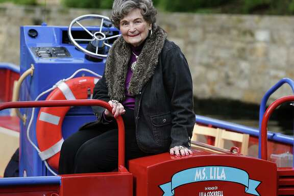 Former San Antonio Mayor Lila Cockrell sits on the back of a river barge named for her earlier this month.