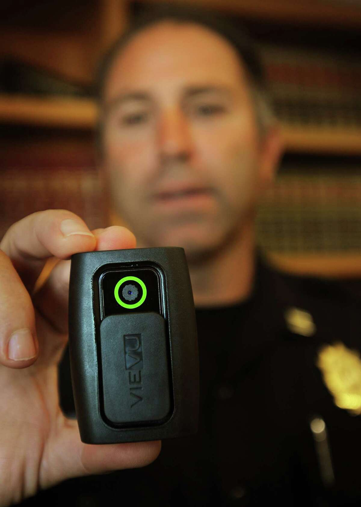 Westport police Captain Sam Arciola holds one of the department's new Vievu body cameras in Westport, Conn. on Thursday, October 9, 2014.
