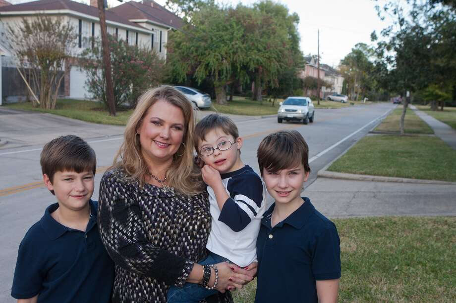 Among those wanting the city of Bellarie to address a traffic speeding problem on Elm Street is resident Danielle Burkhart, shown with sons Carson, left, Reid and Blake. Photo: R. Clayton McKee, Freelance / © R. Clayton McKee