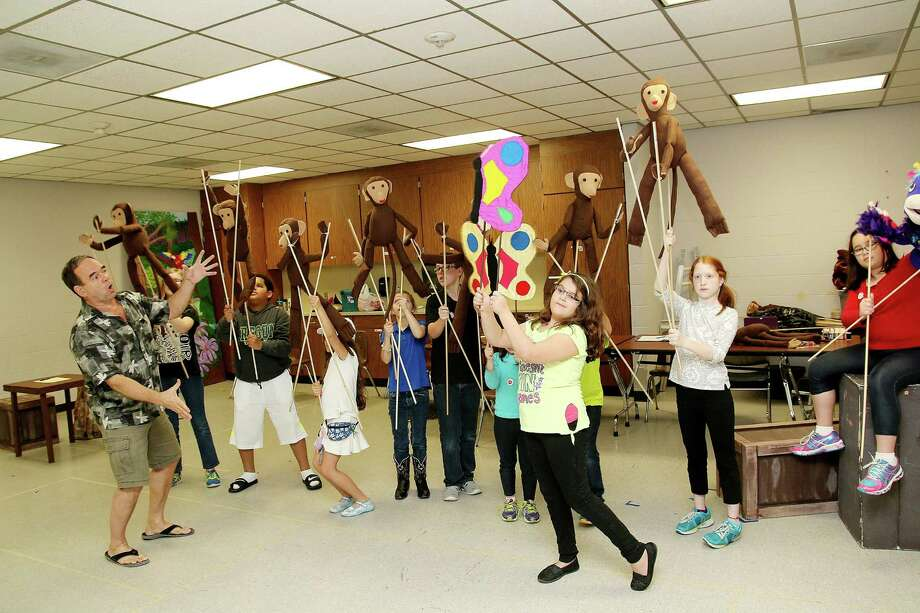 """As he has done for 10 years, Ron Solomon. left. guides a young cast preparing for a Kid's Backporch Production's play. This time, it's the """"Jungle Book,"""" and the rehearsal is at Pearland Community Center. The production after 'The Jungle Book"""" will be """"Winnie the Pooh"""" in May, which will be the group's 50th. Photo: Pin Lim, Freelance / Copyright Forest Photography, 2015."""