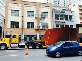 A section of Richard Serra's giant steel sculpture awaits unloading for exhibition at San Francisco's newly renovated Modern Museum of Art.