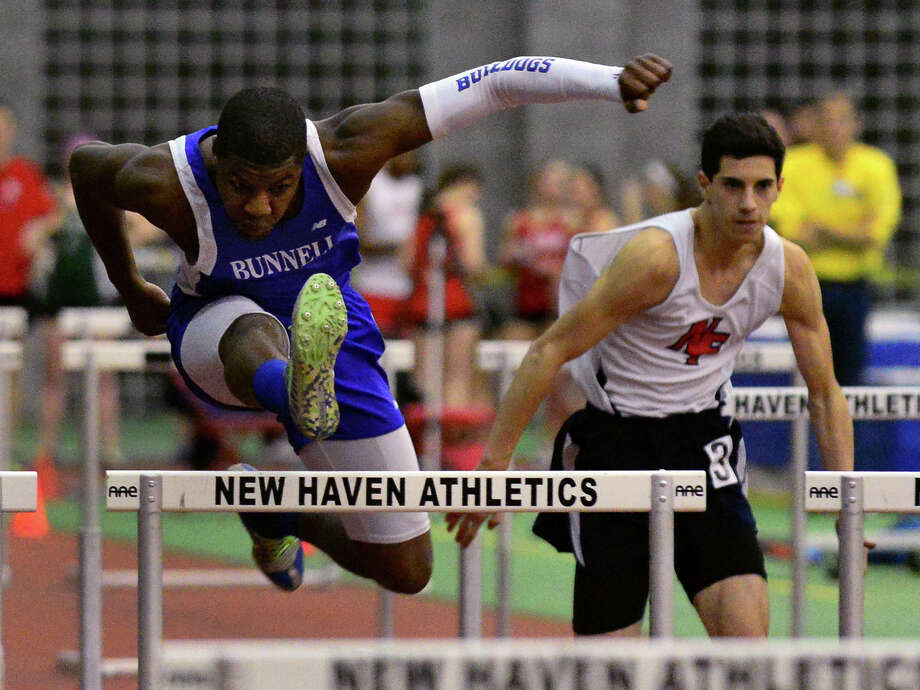 Bunnell's Ruven Exantus competes in the 55 meter hurdles, during SWC boys and girls track championship action in New Haven, Conn. on Saturday Feb. 7, 2015. Photo: Christian Abraham / Connecticut Post
