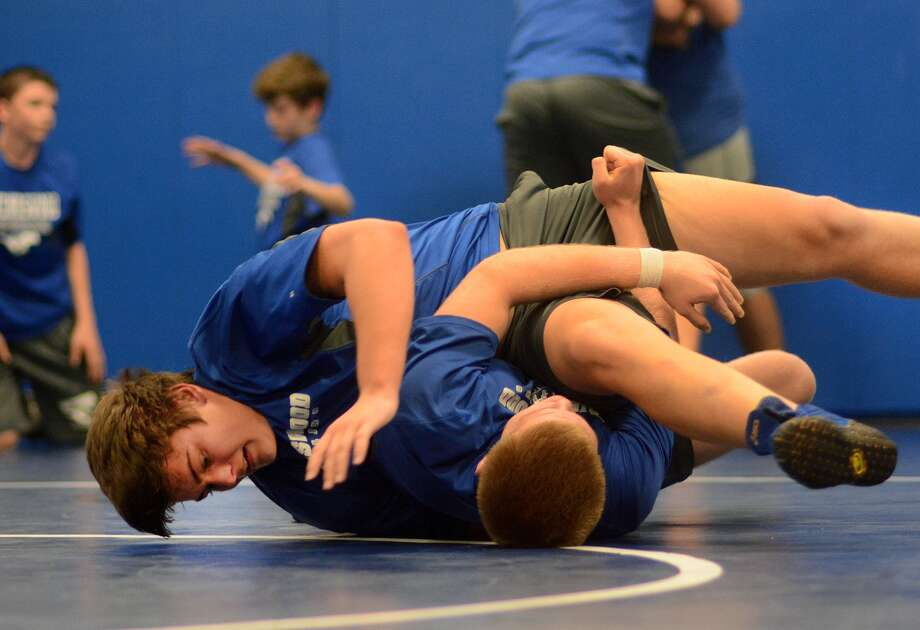 Friendswood High School junior Christian Rains, left, works against teammate Jacob Sadler, also a junior, during a team practice on Jan. 16. Photo: Jerry Baker, Freelance
