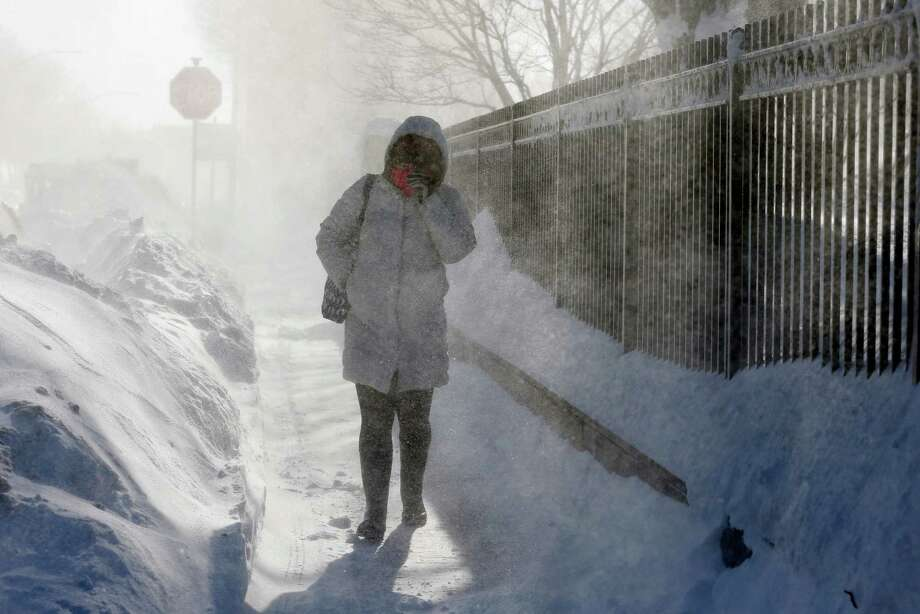 22 photos from historic Boston snowfallA woman walks through blowing snow in the East Boston neighborhood of Boston, Monday, Feb. 16, 2015. New England remained bitterly cold Monday after the region's fourth winter storm in a month blew through. Photo: Michael Dwyer, Associated Press / AP