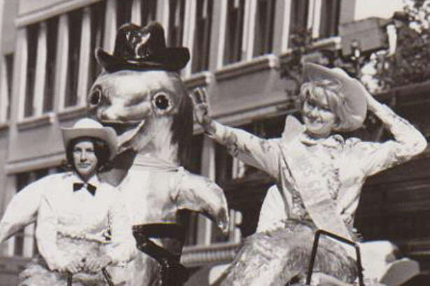 A float representing Sea Arama of Galveston makes its way through downtown Houston during the 1965 Houston Livestock Show and Rodeo parade.