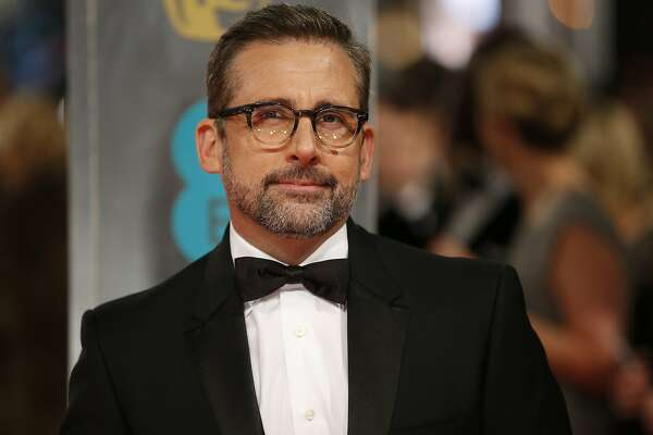 US actor Steve Carrell poses for pictures as he arrives on the red carpet for the BAFTA British Academy Film Awards at the Royal Opera House in London on February 8, 2015. AFP PHOTO / JUSTIN TALLIS (Photo credit should read JUSTIN TALLIS/AFP/Getty Images)