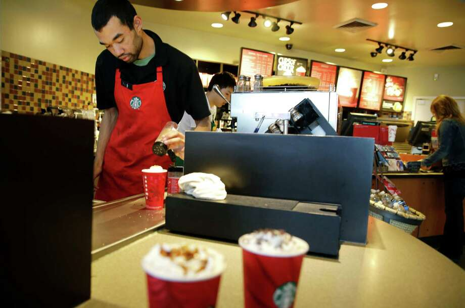 Starbucks is serving new tiramisu lattes, has brought back caramel flan lattes, and will offer a coconut milk option with all its coffee drinks. Photo: Ted S. Warren / Associated Press / AP