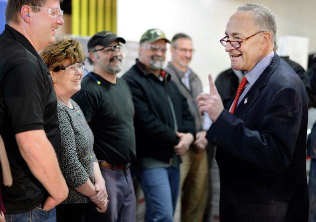 U.S. Senator Charles Schumer, right, speaks with employees during a visit to Finch Paper Tuesday, Feb. 17, 2015, in Glens Falls, N.Y.  (John Carl D'Annibale / Times Union) Photo: John Carl D'Annibale / 00030645A