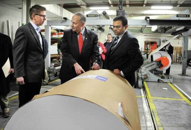 U.S. Senator Charles Schumer, center, tours the Finch Paper with plant manager Eric Wood, left, and President and CEO, Deba Mukherjee Tuesday, Feb. 17, 2015, in Glens Falls, N.Y.  (John Carl D'Annibale / Times Union) Photo: John Carl D'Annibale / 00030645A