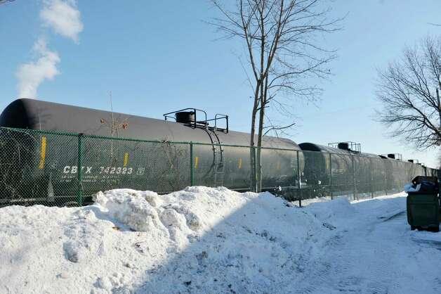 Tanker rail cars are seen on tracks that run by the Ezra Prentice Homes on South Pearl St., on Tuesday, Feb. 17, 2015, in Albany, N.Y.   (Paul Buckowski / Times Union) Photo: PAUL BUCKOWSKI / 00030663A