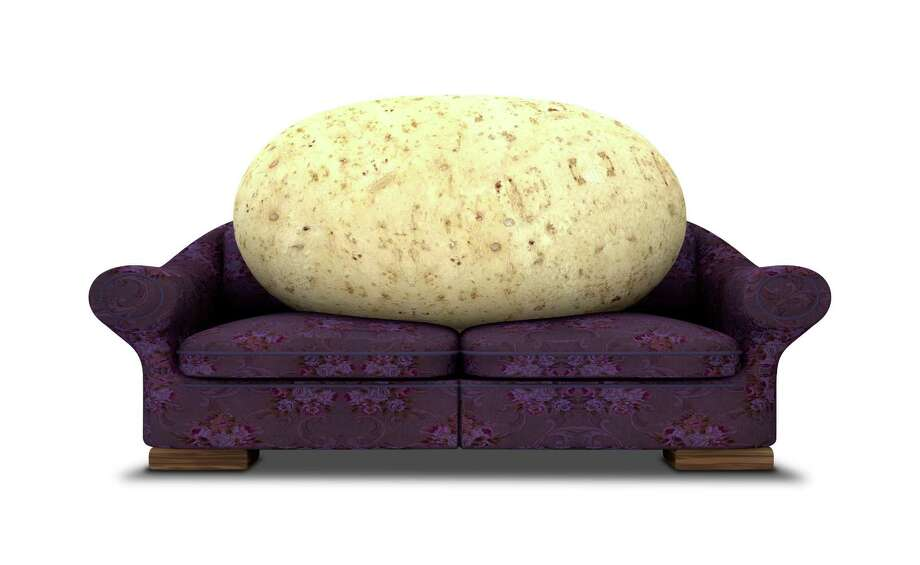 A literal depiction of a potato sitting on a purple floral couch Couch potato FOTOLIA / alswart - Fotolia