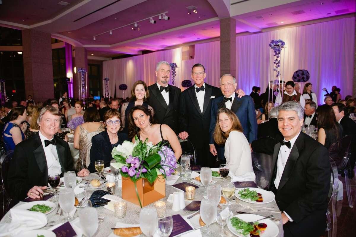 (front row) Bill Powers, Jeanne Klein, Simone Wicha, Kim Helibrun, University of Texas Provost Greg Fenves (back row) Judy Tate, Jack Shear, Charles Tate, and Mickey Klein