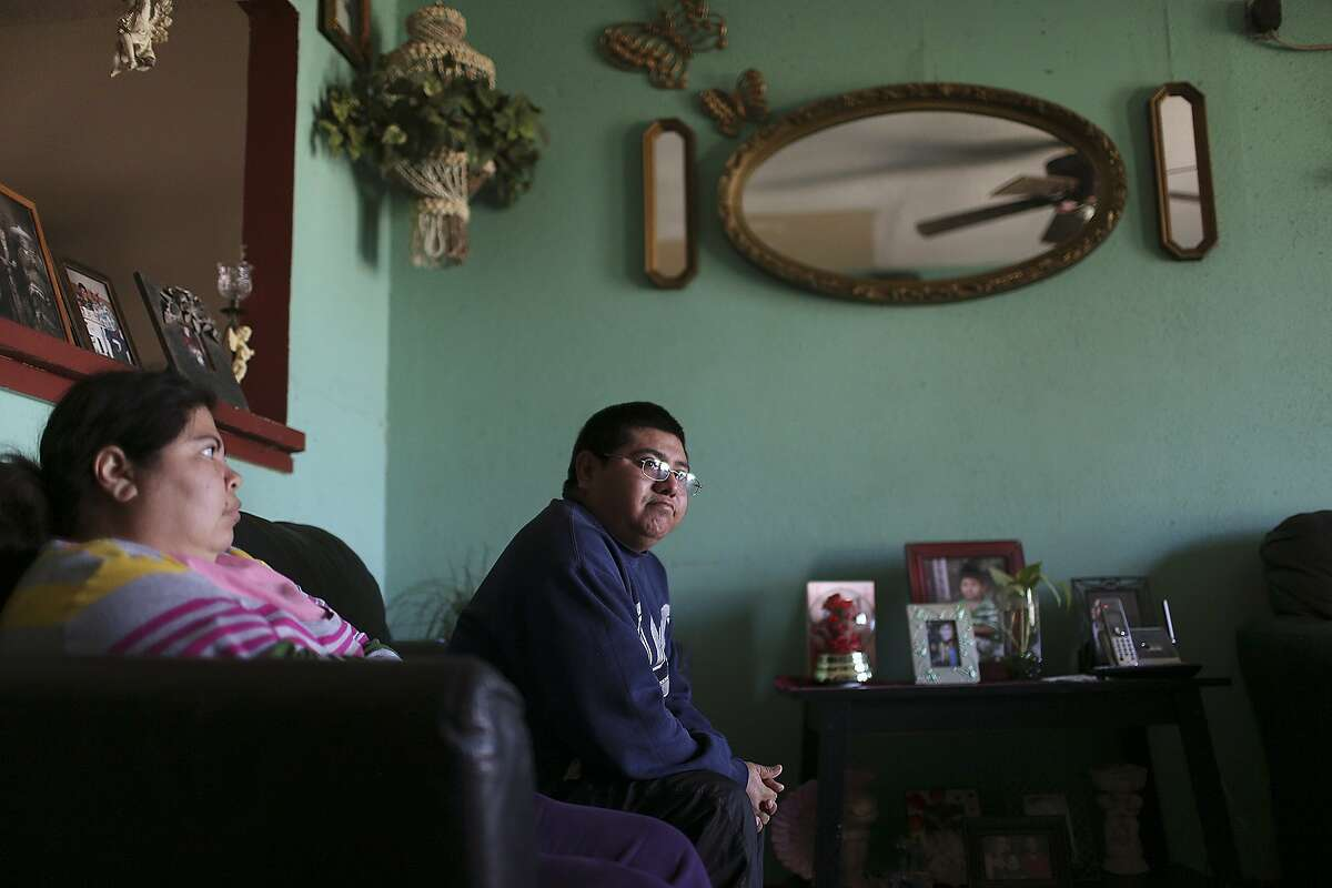 Luis Humberto Morales, 33, right, sits in the living of his west side home with his wife, Maria, 37, Tuesday, February 17, 2015. Morales, a construction worker, was hoping to apply for a temporary work permit through President Barack Obama's executive action on immigration. But his plans are on hold after Brownsville Federal Judge Andrew Hanen halting part of Obama's immigration reform.