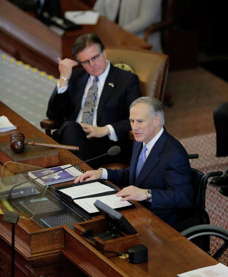 Texas Gov. Greg Abbott, right, delivers his State of the State address to a joint session of the House and Senate, Tuesday in Austin, Texas. Texas Lt. Gov. Dan Patrick is at left. (AP Photo/Eric Gay) Photo: Eric Gay, STF / AP