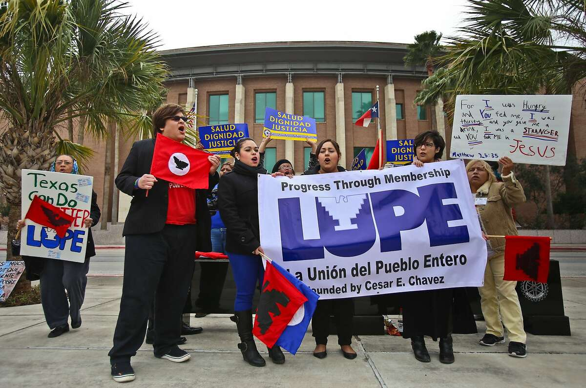 A group of protesters gather outside of the federal courthouse in Brownsville, Texas, Tuesday, Feb. 17, 2015 noon to protest the preliminary injunction on immigration case that was granted by U.S. District Judge Andrew Hanen. (AP Photo/The Brownsville Herald, Yvette Vela)