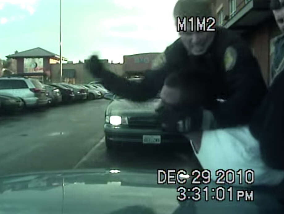 Isaac Ocak and Seattle police Officer Larry Longley, pictured in a still taken from an in-car camera that captured Ocak's arrest on Dec. 29, 2010. Photo: Seattle Police Department Video