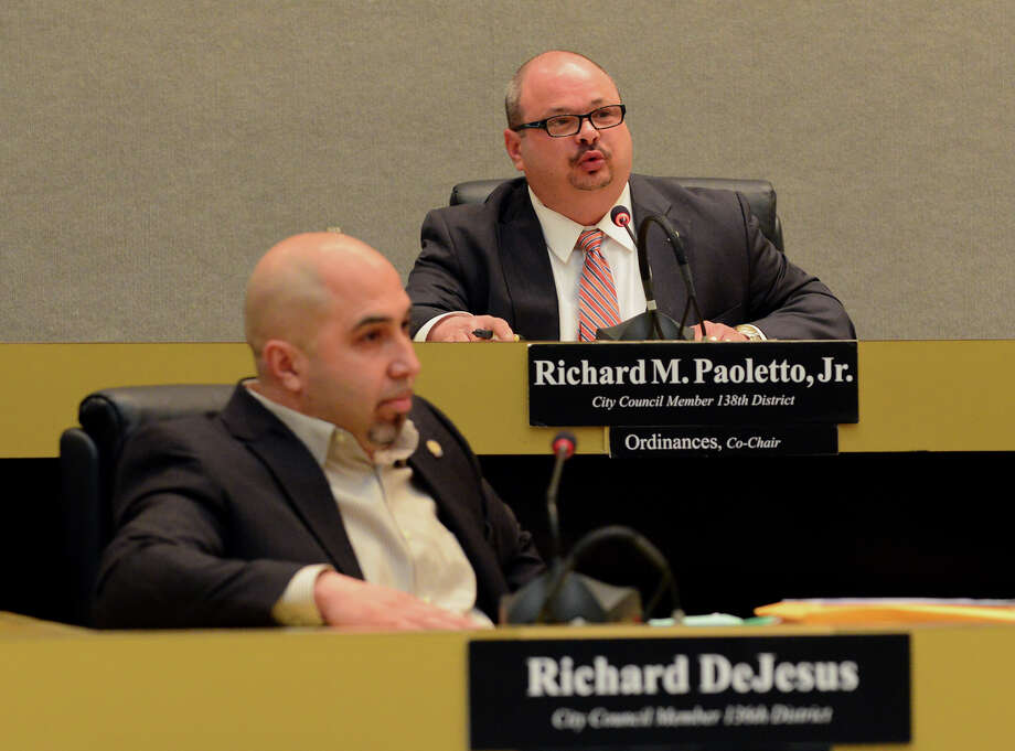 Bridgeport City Councilman Richard Paoletto, at top, reads a statement during the council's meeting at Bridgeport City Hall in  Bridgeport, Conn. on Tuesday Feb. 17, 2015. This is last meeting for Paoletto and Richard DeJesus, both of whom are resigning. Photo: Christian Abraham / Connecticut Post